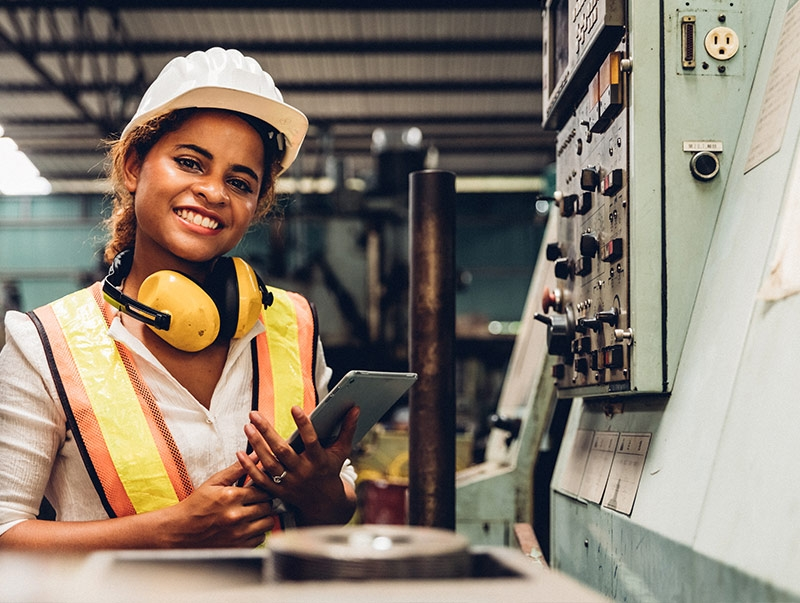 lady in industrial setting with tablet