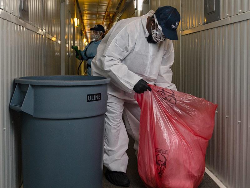 Lady filling trash bags