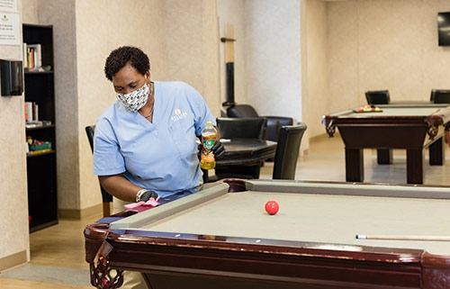 Lady cleaning pool table