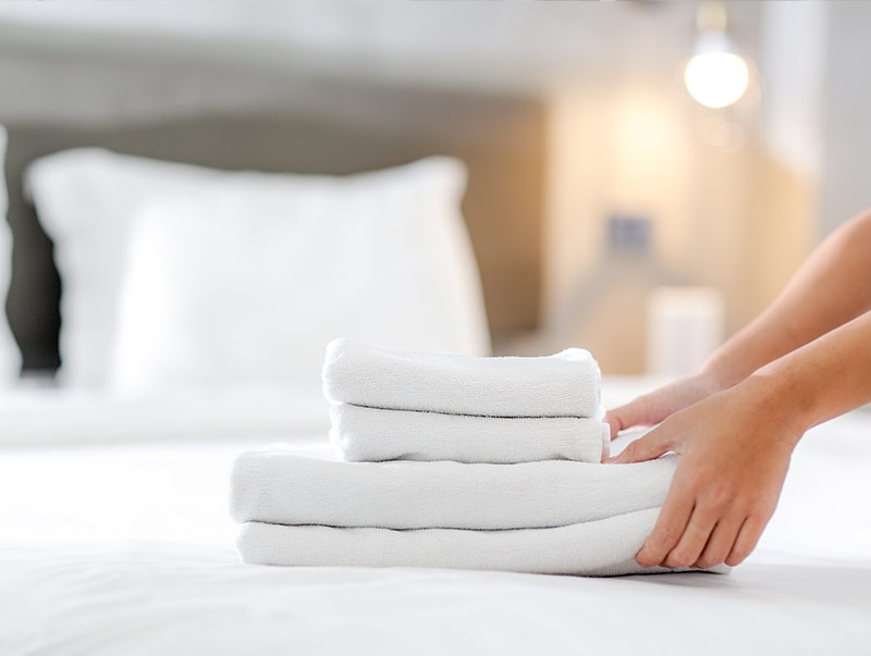 Clean towels on bed
